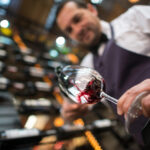 Sommelier pouring a glass of wine